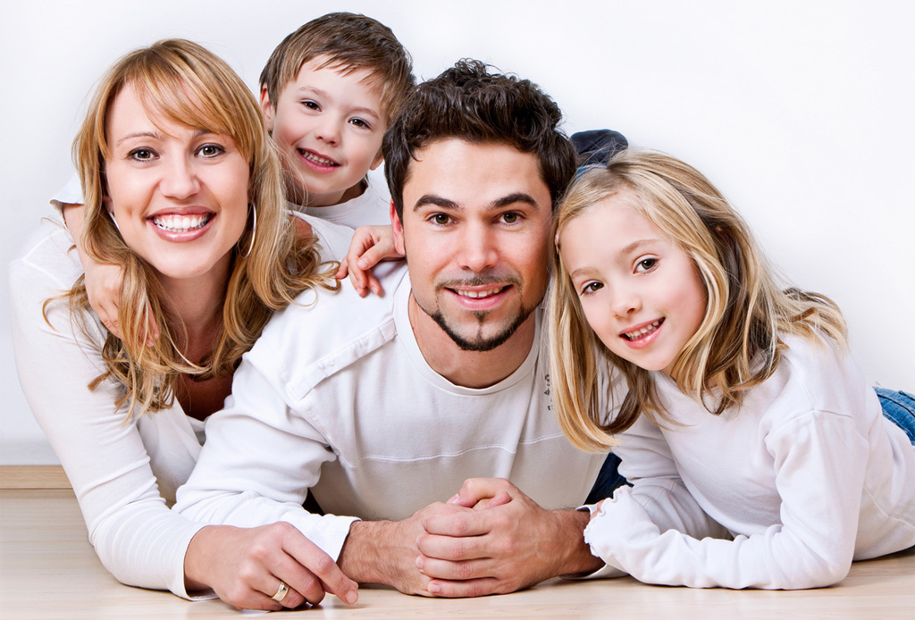 Happy parents with two young children
