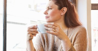 a-woman-drinking-coffee-in-a-cafe