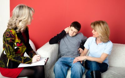 Child and parent in therapy session psychologist